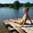Little girl sits on a raft — Stock Photo