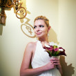 Handsome bride standing near lights candles — Stock Photo