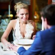 Loving couple at a table in restaurant — Stock Photo