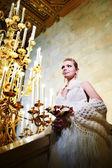 Elegant bride in interior of hotel — Stock Photo