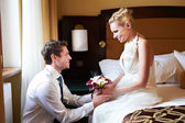 Happy bride and groom in bedroom — Stock Photo