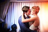 Kiss bride and groom — Stock Photo