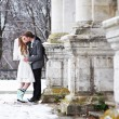 Happy bride and groom kissing near old castle — Stock Photo