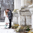 Stock Photo: Happy bride and groom kissing near old castle