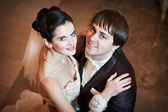 Happy bride and groom embraced — 图库照片