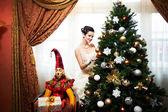 Beautiful bridenear christmas tree — Stock Photo