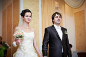 Bride and groom at the ceremony of marriage registration — ストック写真