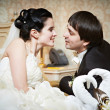 Handsome bride and groom in bedroom — Stock Photo