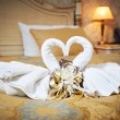 Swans out of towels on the bed — Stock Photo