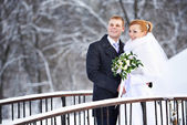 Happy bride and groom on winter day — Stock Photo
