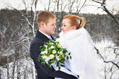 Happy bride and groom on winter wedding day — Stock Photo