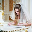 Stock Photo: Bride signs on solemn registration of marriage