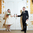 Bride and groom near doors of wedding hall — Stock Photo