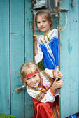 Two girls in Russian national costumes — Stock Photo