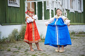 Two girls in national costumes in Russian village — Stock Photo
