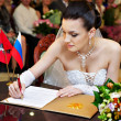 Stock Photo: Happy bride on solemn registration of marriage in Wedding Palace
