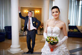 Happy bride and groom in wedding palace — Stock Photo