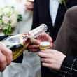Bottle of champagne and a glass — Stock Photo
