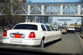 Wedding limousine on city street — Photo