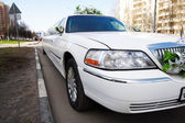 Wedding limousine on city street — Stock Photo