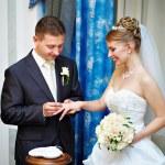 Groom wears wedding ring happy bride — Stock Photo