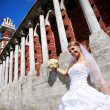 Happy Bride at wall to palace — Stock Photo
