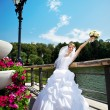 Happy beautiful bride in park — стоковое фото #40592091