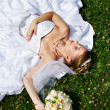 Stok fotoğraf: Happy sleeping bride are on grass