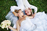 Bride and groom on grass — Stock Photo