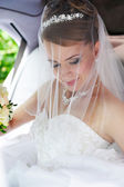 Beauty bride in wedding limo — Stock Photo
