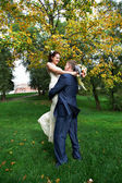 Romantic bride and groom embrace — Foto Stock