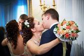 Kiss happy bride and groom — Stock Photo
