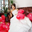 Happy bride with red balls — Stock Photo