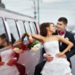 Stock Photo: Happy bride and groom near wedding limo