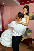 Embrace bride and groom — Stock Photo