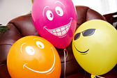 Three fanny multicolored balloons — Stock Photo