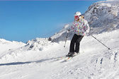 Little skier girl in slope of snow alps — Zdjęcie stockowe