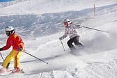 Two little skiers in slope of snow alps — ストック写真