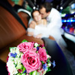 Stock Photo: Wedding bouquet of flowers in limo