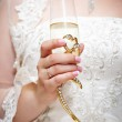 Wedding glass of champagne in hand bride — Stock Photo #41223263