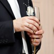 Wedding glass of champagne in hand groom — Stock Photo #41223339
