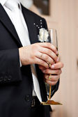 Wedding glass of champagne in hand groom — Stock Photo