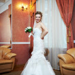 Stock Photo: Happy beautiful bride in interior wedding palace