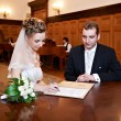 Stock Photo: Happy bride and groom on solemn registration of marriage