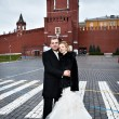 Happy bride and groom on Red Square near Kremlin — Stock Photo