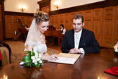 Happy bride and groom on solemn registration of marriage — Stock Photo