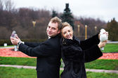 Bride and groom with pigeons on hands — Stock Photo