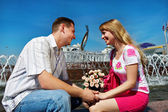 Romantic dating young guy and girl in city square — Stock Photo