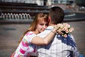Romantic hug the guy and girl — Stock Photo