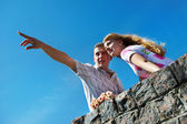 Young man show his girlfriend that in the distance — Stock Photo